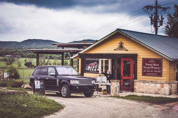 vehicle using curbside service at tasting room